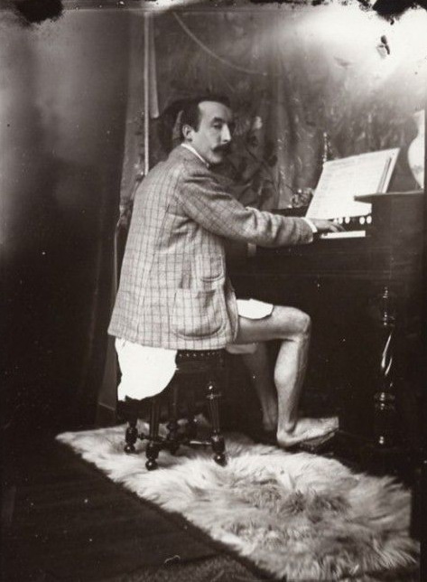 Paul Gaugin, not wearing pants and playing an organ, Paris, 1800s