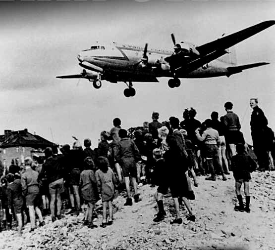 """Female pilot from Britain """"candy bombing"""" (dropping candy and snacks) to kids in West Berlin during the Soviet Blockade,1948"""