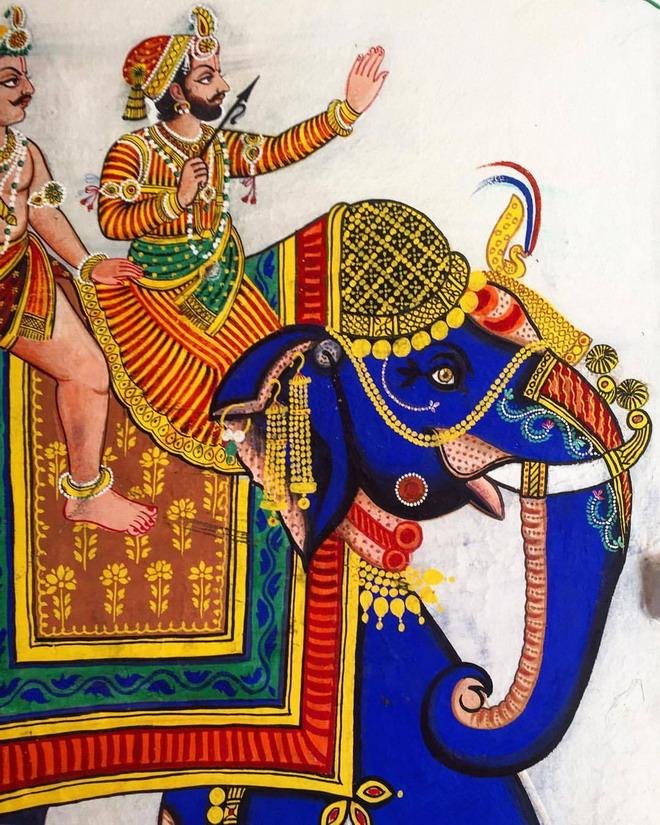 Two men riding an elephant,India