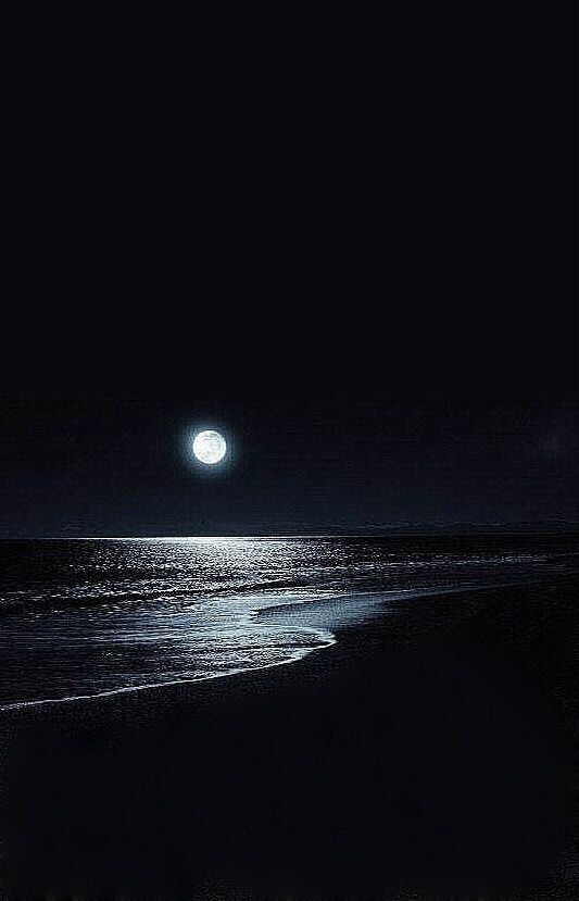 Moonlight on the water at a beach