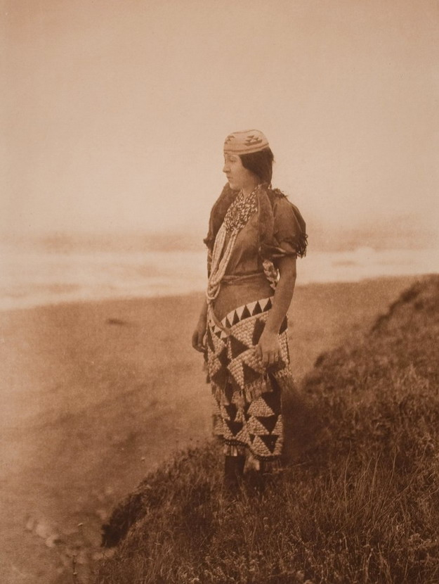 Native North American woman standing on the shore of the Pacific,1800s