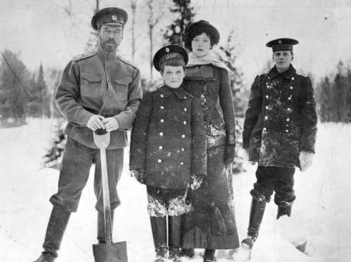 A gaunt Nicholas II and two of his children (with a Bolshevik guard in the background) during their final winter under house arrest in Siberia