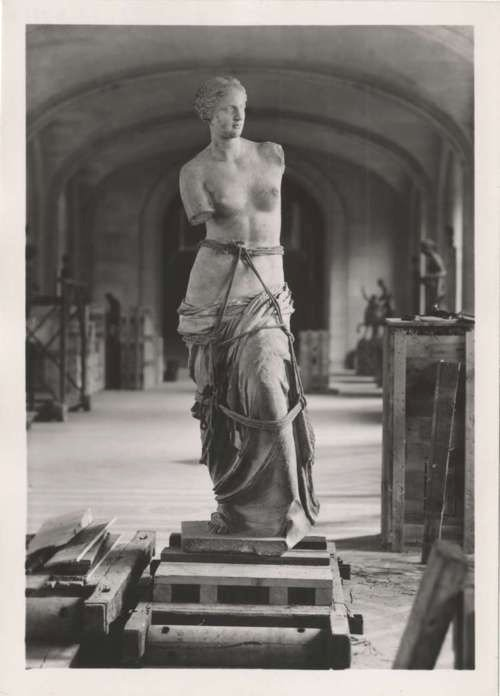 The Venus de Milo statue being packed up to be evacuated out of the Louvre & Paris for safekeeping before the Nazis invaded,1940