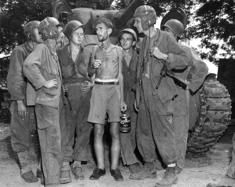 American soldiers after liberating an American from a Japanese POW Camp, WWII