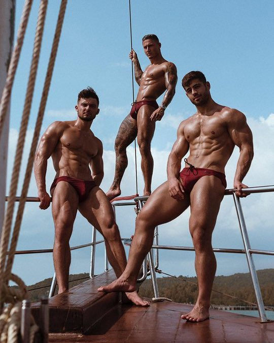 Swimwear models on a boat