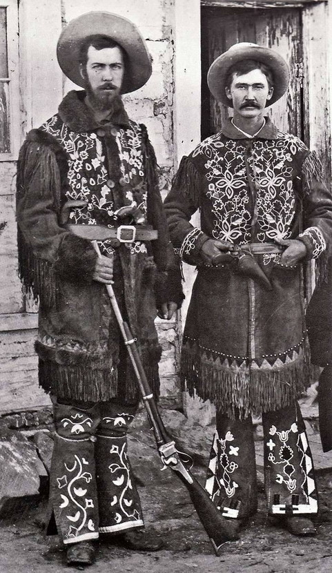 Cowboys wearing clothing embroidered by Native North Americans, Washington state,1800s