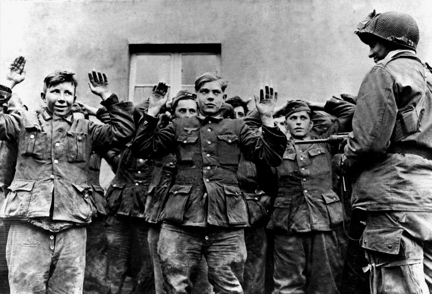 Teenage Nazi soldiers being arrested near the end of WWII, Germany, 1945