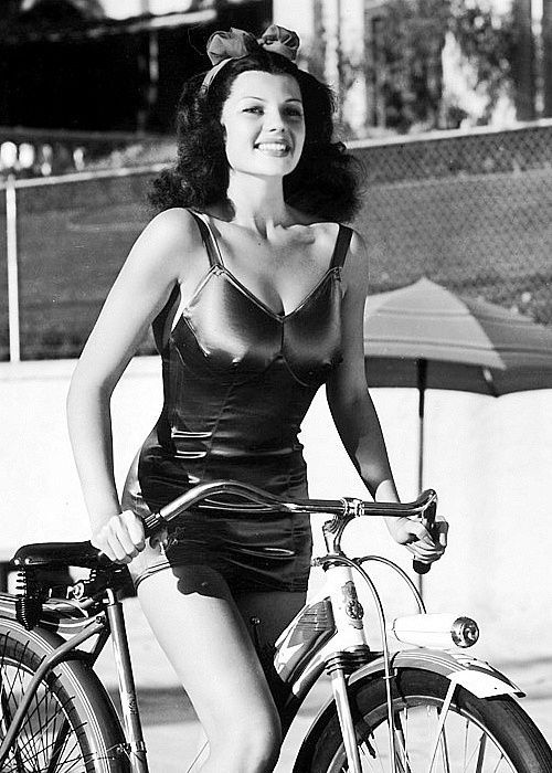 Rita Hayworth with a bicycle