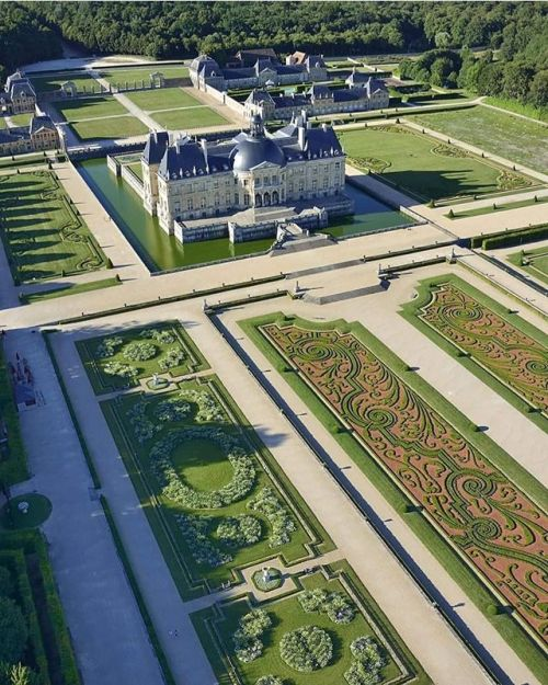 Castle with moat and ornate gardens. France