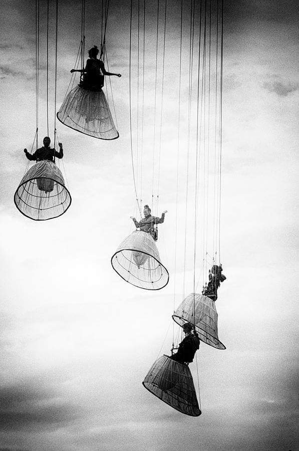 Women in hoop skirts descending from theclouds