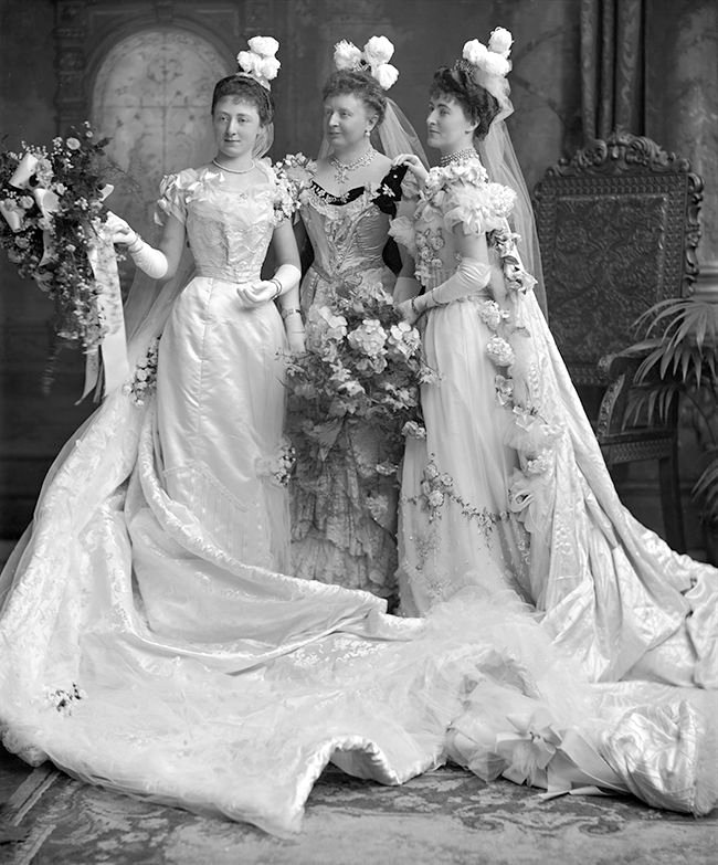 Ladies dressed in court attire, England, 1900