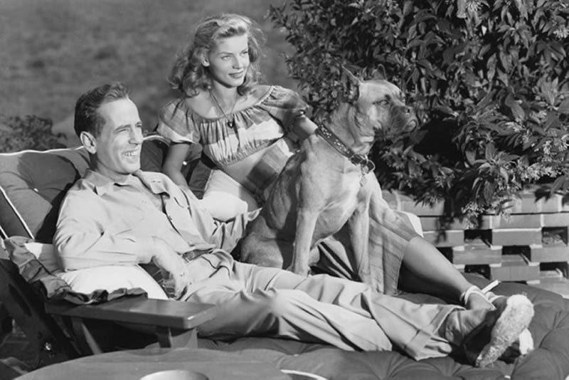 Bogart & Bacall at home with one of their dogs, 1940s