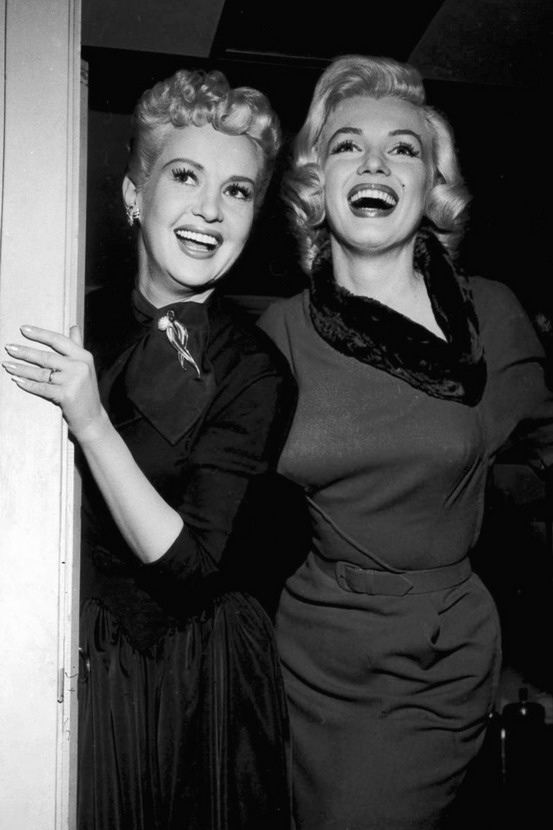 "Betty Grable and Marilyn Monroe on the set of ""How To Marry a Millionaire"""