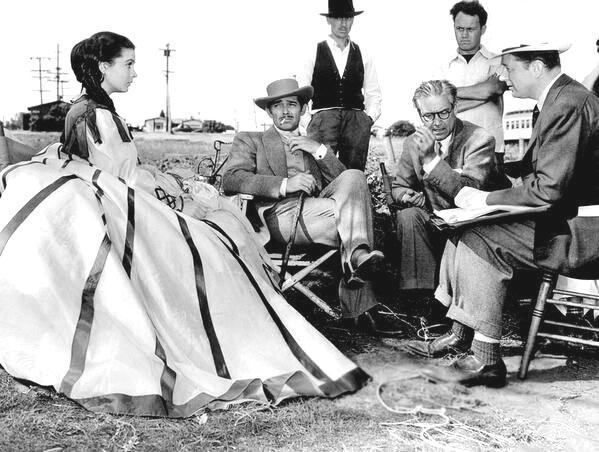 "Vivien Leigh and Clark Gable taking a smoke break during the filming of ""Gone With the Wind"""