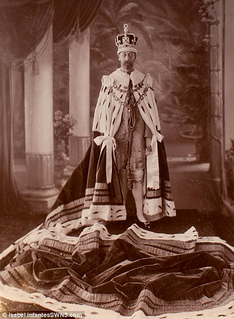 King George V… in his pajamas and bathrobe