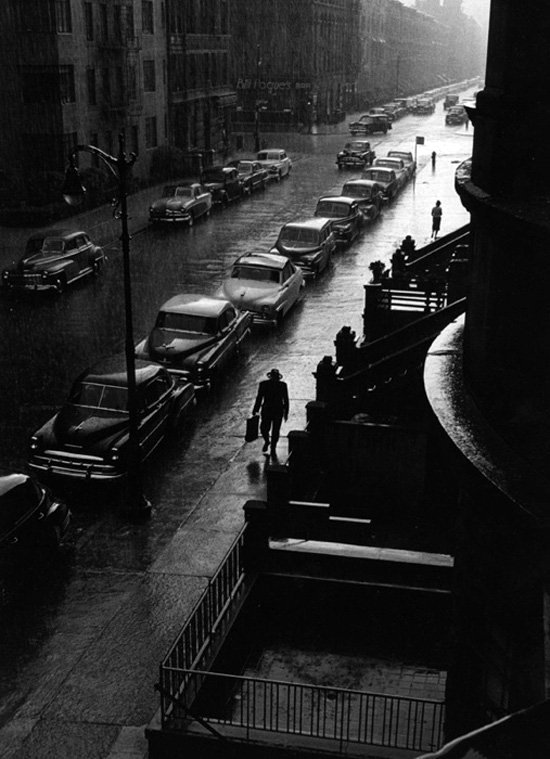 Man in the rain, NYC, photo by Ruth Orkin, early 1950s