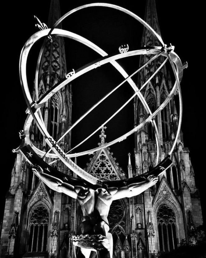 The Atlas Statue at Rockefeller Center with St. Patrick's Cathedral across thestreet