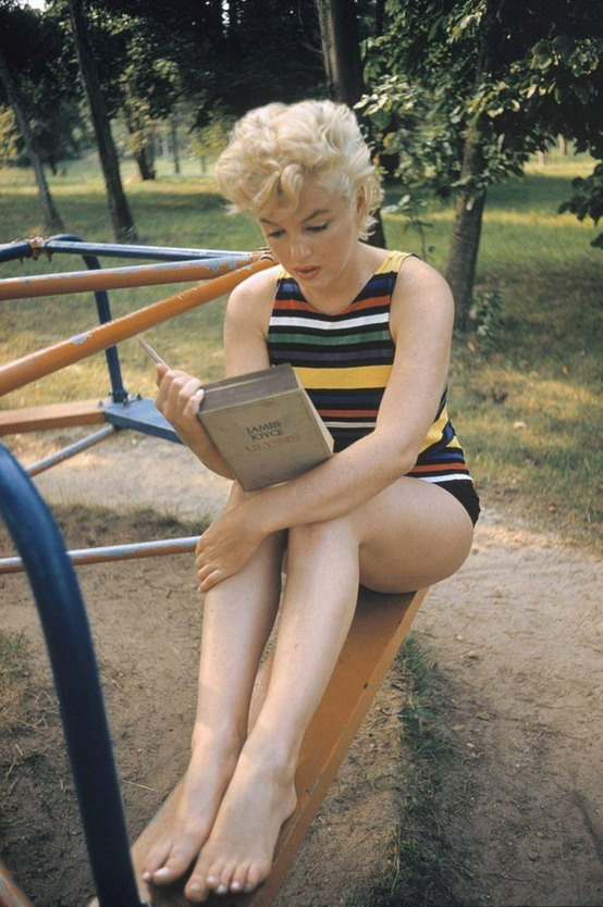 "Marilyn Monroe in a playground reading James Joyce's ""Ulysses"""