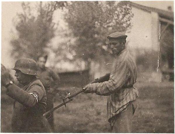 After the liberation of a Nazi concentration camp a prisoner arrests a guard