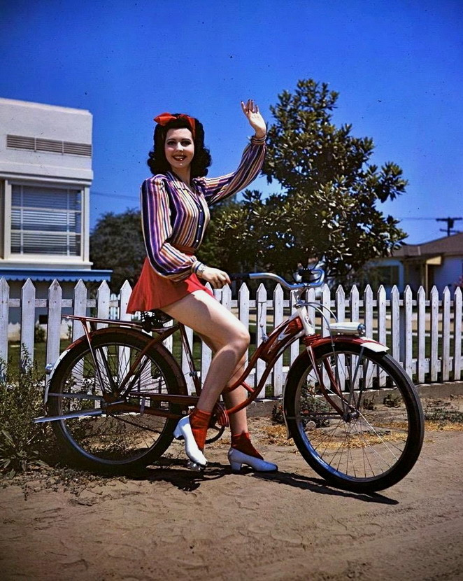 Ann Miller on a bicycle,1940s