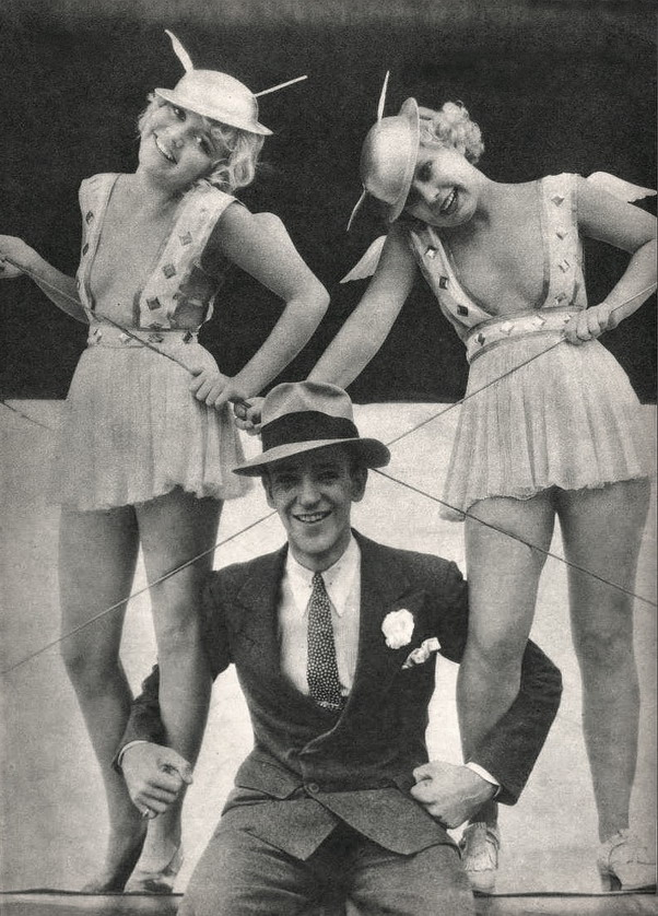 "Fred Astaire with two dancers in ""Flying Down to Rio"", 1933"