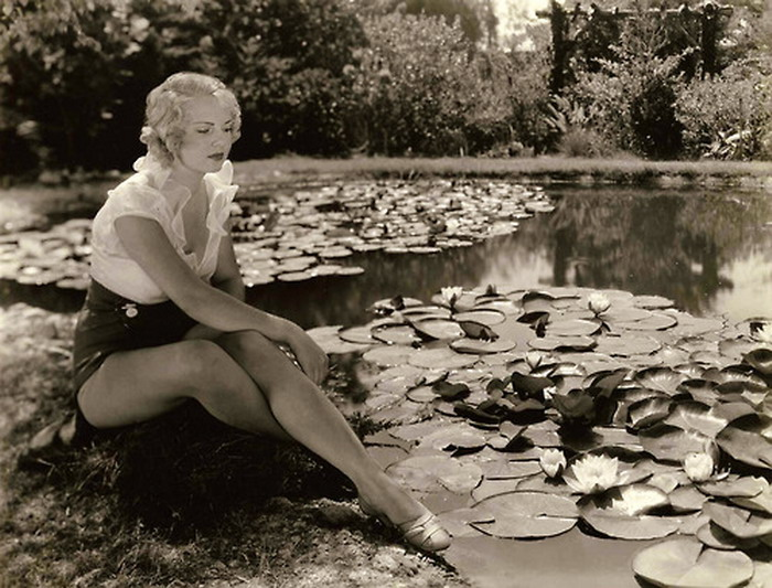 Woman by a lily pond