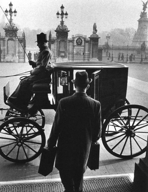 The Queen's messenger getting into a carriage to take a royal dispatch to the Foreign Office, 1950s