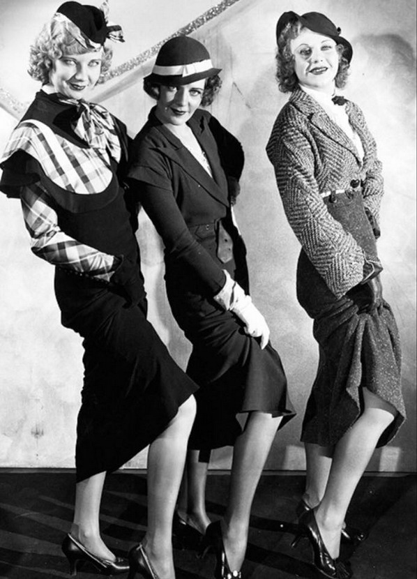 Una Merkel, Ruby Keeler, and Ginger Rogers showing off their gams
