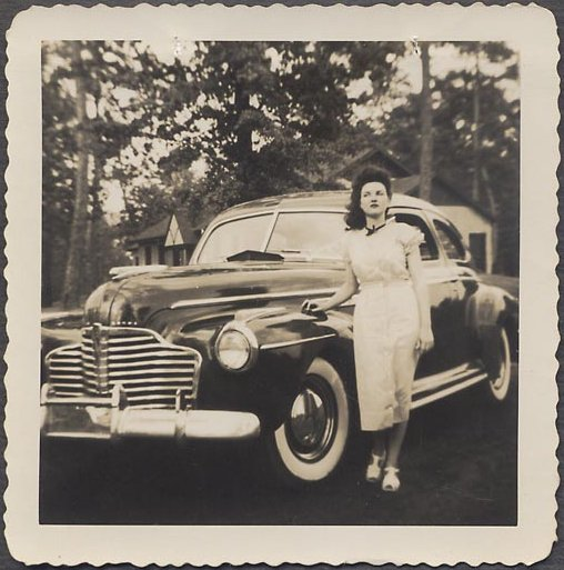 Woman and a car, circa 1940