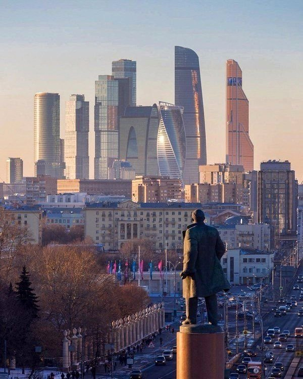Statue of Lenin facing capitalist skyscrapers, Moscow
