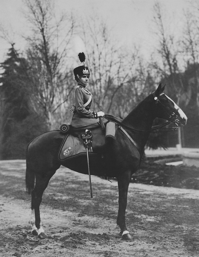 Queen Victoria Eugenie of Spain on a horse