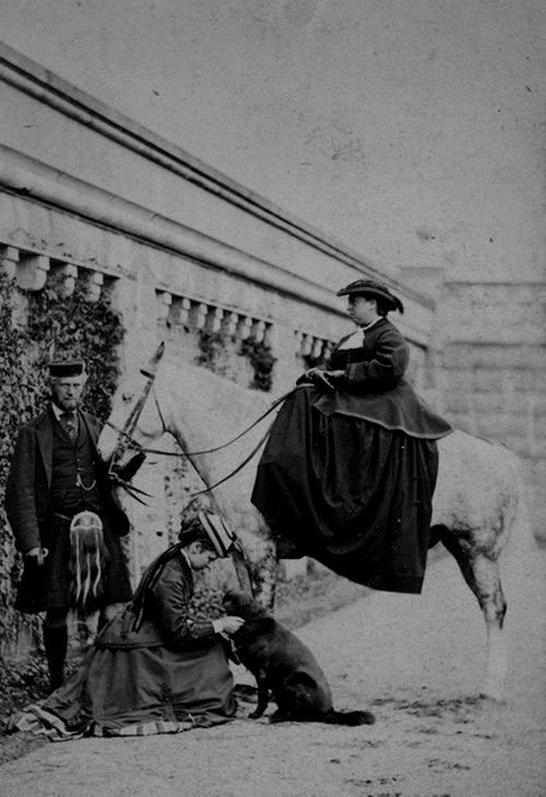 Queen Victoria on a horse, with one of her daughters and John Brown