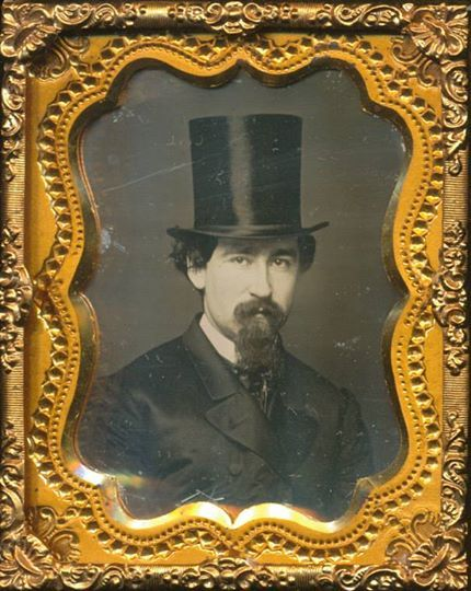 Man wearing a stovepipe hat