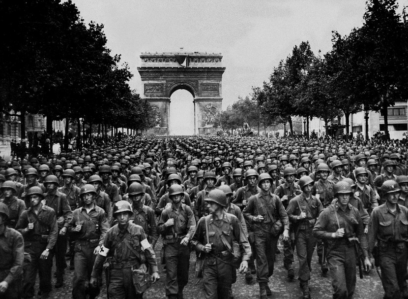 "American soldiers marching in Paris in ""the Liberators Parade"" after kicking out the Nazis, 1944"