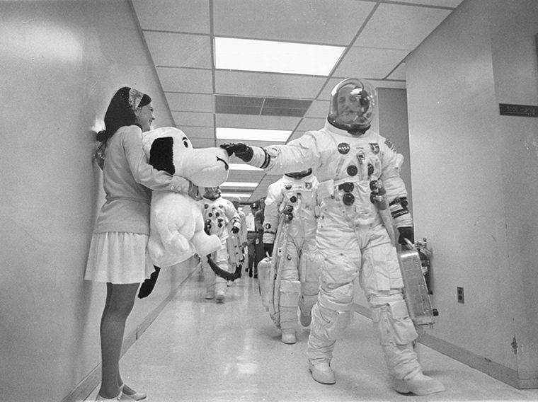 Apollo 10 astronauts touching Snoopy's nose before blasting into space to orbit the moon in a dress rehearsal for the later Apollo 11 mission that did land on the moon
