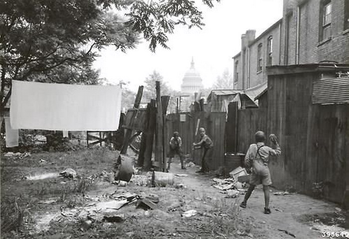 Kids playing baseball in a back alley, Washington DC, 1930s