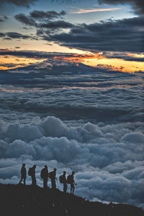 Hikers above the clouds