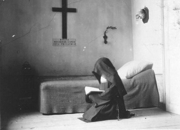 Nun praying, France, 1920s
