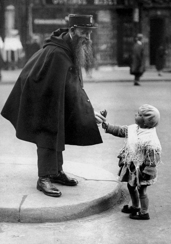 French policeman receiving a flower from a child, 1920s