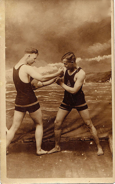 Vintage men sparring in swimsuits
