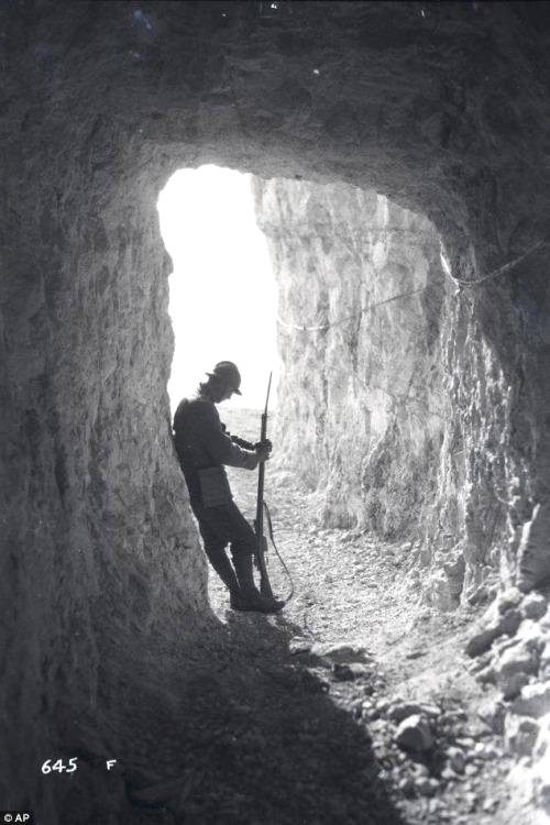 Italian soldier standing at the entrance of a cave, WWI