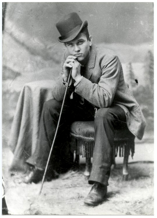 Man with hat and cane, 1890s