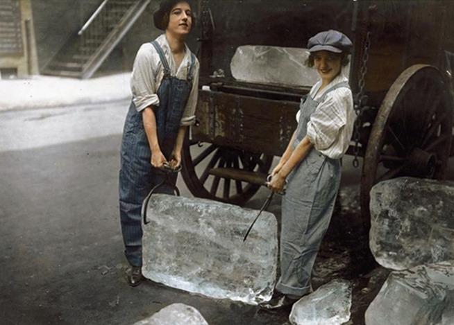 Colourized photo of ladies hauling ice blocks to be used forrefrigeration