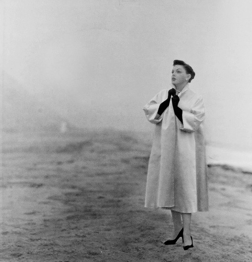 Judy Garland on the beach in Malibu, posing for an album cover shoot in the fog