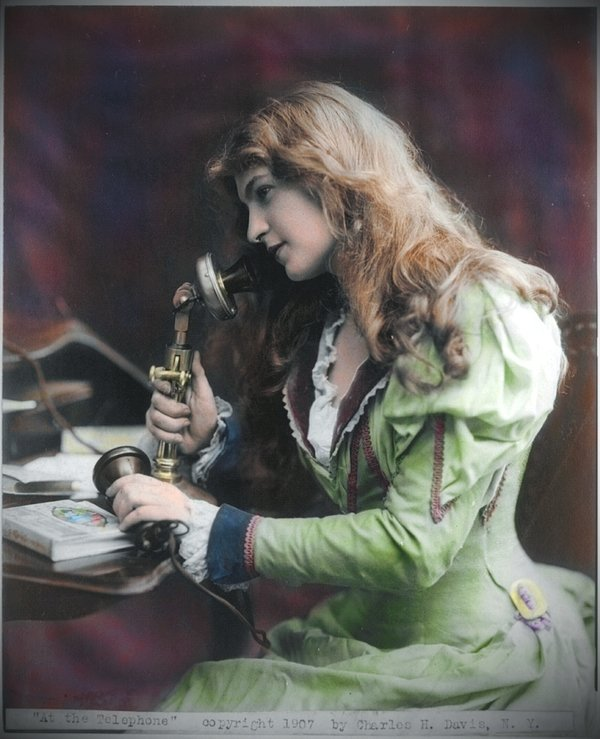 Woman using a phone, 1907