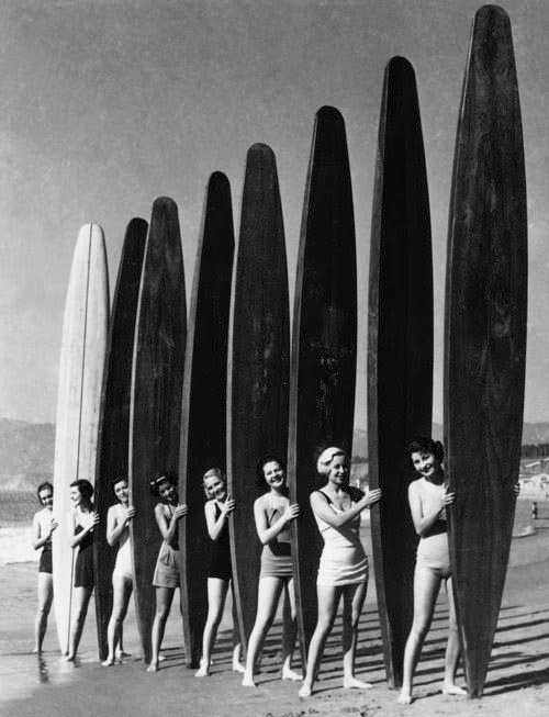 Women with longboards (over-sized surf boards), California, late1940s