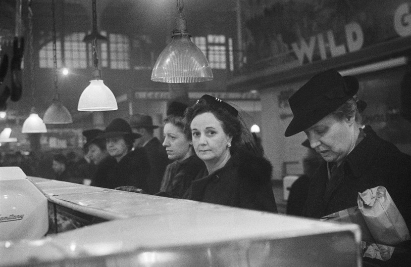 Women waiting at the meat counter – the faces of WWII on the home front, photo by RomanVishniac
