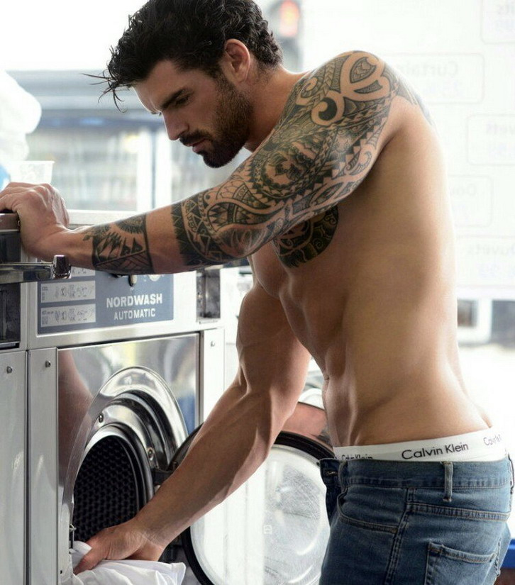 Shirtless model doinglaundry