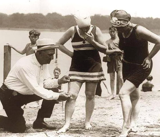 Checking to make sure newfangled swimwear is in compliance with code,1920s