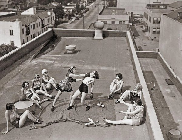 Women boxing on a rooftop,1920s